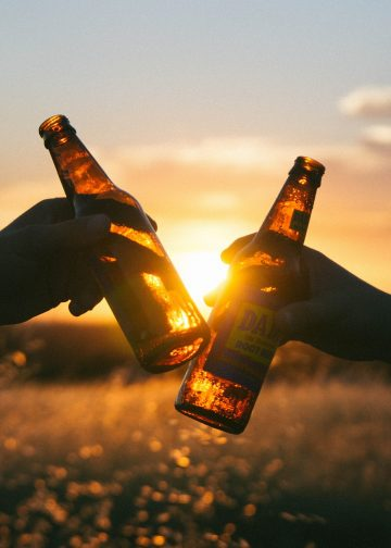 two beer bottles in the sunset